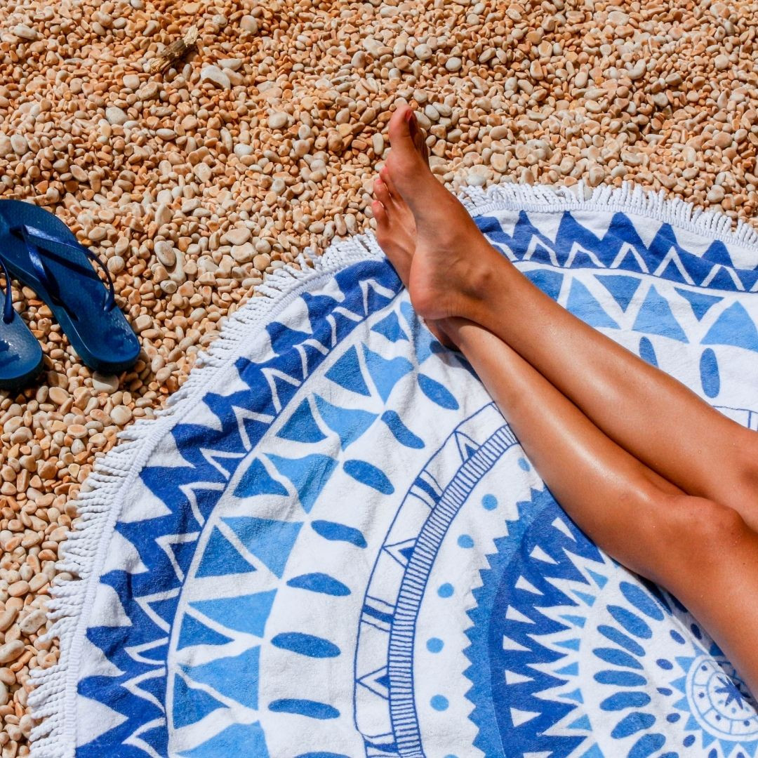 woman lying on a towel at a beach