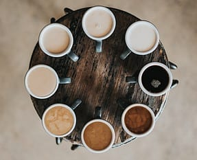 A circle made of different types of coffee in cups