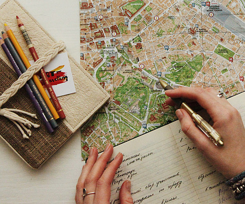 Person looking at city map and planning their trip
