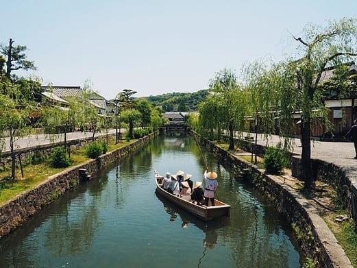 people-in-a-canoe-down-a-canal-in-kurashiki-japan