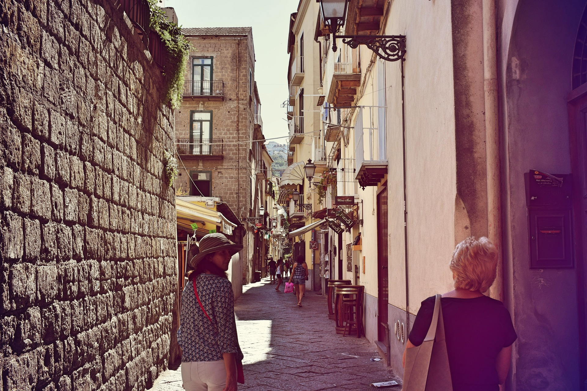 Image of a laneway in old town Sorrento Italy with two women walking down the street