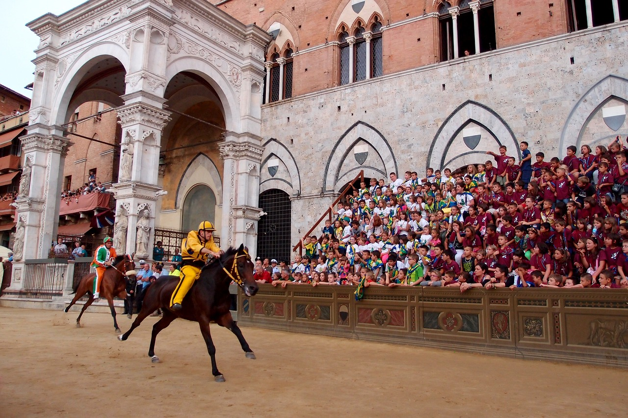Photo of a rider on horse racing the Palio in Siena